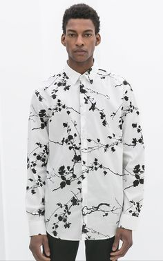 Mens White and Black printed shirt.