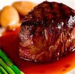 Fillet mignon. Marinate steak in 1 cup of red wine, a 1/3 cup soy sauce, a clove of garlic, and some salt and pepper. Leave for a couple hours, grill and serve medium rare. Delicious and juicy
