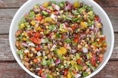 Cowboy Caviar   12 oz shoe peg corn, drained  12 ozs  black beans, rinsed drained   12 ozs  black eyed peas, rinsed  drained    5 roma tomatoes, seeds removed  diced or diced cherry tomatoes    1 bunch green onions, chopped   1 bunch cilantro, chopped   1 can  salsa   half  red onion   Italian dressing to cover the mixture   fresh lime   1 avocado, chopped   Combine corn, beans, onion and cilantro, Add juice of lime and dressing. Just before serving add avocado. Serve cold with corn chips.