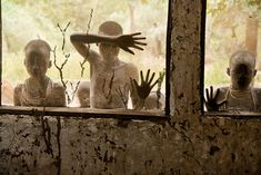 Children from the Kara tribe look through windows, Omo Valley, Ethiopia, 2013 by Steve McCurry