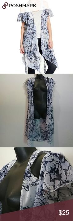 Bcbg Nwt floral blue sheer cold shoulder Duster Bcbg nwt cold should duster..says one size..but can fit up to a sz large..blue floral sheer very nice..please feel free to ask any questions..Thank you Happy Poshing! BCBGeneration Tops