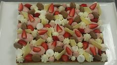 Vanilla sponge/ white choc mousse/ dark choc mousse/ cocoa macaron/ strawberry