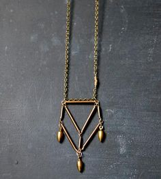 Brass Pentahedron Necklace with Bullet Drops | This geometric necklace features a pentahedron, formed in bras... | Necklaces