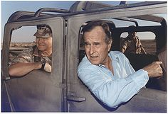 President George HW Bush rides in a HUMVEE with General H. Norman Schwarzkopf during his visit with troops in Saudi Arabia on Thanksgiving Day, 11/22/1990