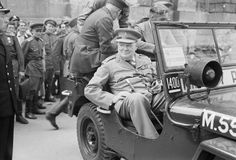 Prime Minister Winston Churchill sits in a jeep outside the Reichstag during a tour of the ruined city of Berlin, Germany on 16 July 1945 -- three and a half months after Hitler committed suicide in his underground bunker.
