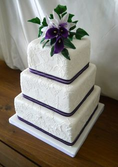Wedding Cake With lace butterflies, sugar orchids and purple calla lilies