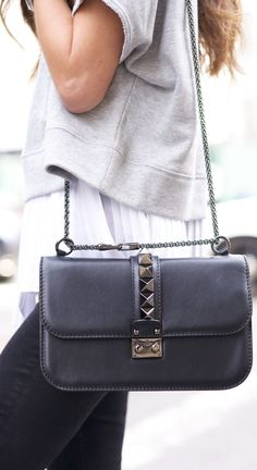 It is all about the bag, isn't it? This is the black and gunmetal rockstud chain mini lock bag from Valentino Via Arielle Nachami