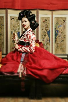 "The Hanbok is the traditional of Korea, also known as the ""land of white people"" because the Koreans wore white 3 years after the death of royalty. The skirt of the Hanbok is tied under the arms and is worn high on the chest. Korean Traditional Clothes, Traditional Fashion, Traditional Dresses, Korean Hanbok, Korean Dress, Korean Outfits, Ha Ji Won, Geisha, Korean Beauty"
