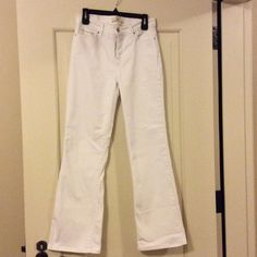 "Levis 512 White Slimming Bootcut Jeans, size 10M Excellent condition Levis 512 white Bootcut jeans, size 10. Perfectly slimming fit. Measures 30"" waist, 32"" length, 31"" inseam, 11 1/2"" rise. Levi's Jeans Boot Cut"
