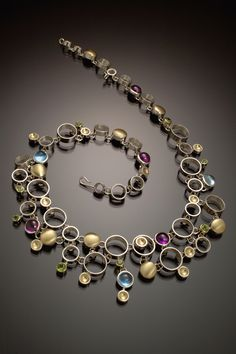 Danielle Miller-Gilliam 'Effervescence' Hand fabricated sterling silver & 18k gold with amethyst, blue topaz & peridot