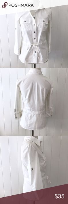 "Michael Kors Button Down Shirt Crisp white button down shirt with three-quarter sleeves. Has front pockets, button cuffs and a drawstring waist. Perfect for the office or paired with your favorite jeans for a more casual look.   Size Petite/Small. Excellent condition. Never worn.   Materials: 97% Cotton; 3% Spandex. Measurements laid flat: 32"" Bust; 21.25"" Length; 14.75"" Shoulders; 17"" Sleeves.  Pet friendly home • No trades/holds/paypal • Reasonable offers welcomed • Bundle to save more…"