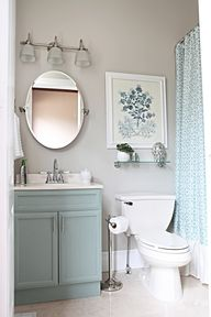 I like the shelf and art above the toilet, the oval mirror, and the light fixture bathroom colors, bathroom makeovers, color schemes, cabinet colors, blue, small bathroom makeover, small bathrooms, pretty bathroom, shower curtains