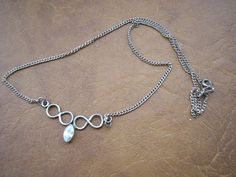 Art deco sterling silver small elegant necklace with by badgestuff, $15.00