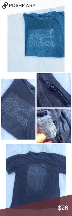 •Brandy Melville• [rare] Good Vibes tee Vintage style, slightly oversized tee by Brandy Melville. Condition is 9/10: fading is intentional with some discoloration for the vintage feel. No holes. It has the appearance of having piling, but when you touch it, it's completely smooth. Made of 100% cotton. Perfect tied up with a pair of high waisted shorts. Please note the color difference in photos. Photo 1 has a filter; however, the other 3 photos do not. All were taken in natural sunlight with…