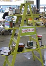A ladder for displaying stuff at craft shows! Brilliant! Super cute, can be painted and folds easily for transportation!