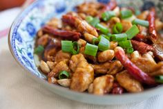 Kung Pao Chicken (宫保鸡丁) Recipe Main Dishes with boneless skinless chicken breasts, roasted peanuts, red chili peppers, cooking oil, peeled fresh ginger, garlic, scallions, corn starch, soy sauce, Shaoxing wine, oil, light soy sauce, dark soy sauce, sugar, black vinegar, water, corn starch