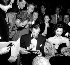 Frank Sinatra and Eva Gardner sign autographs