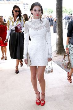 Atlanta De Cadenet Taylor in a white embellished dress and red heels
