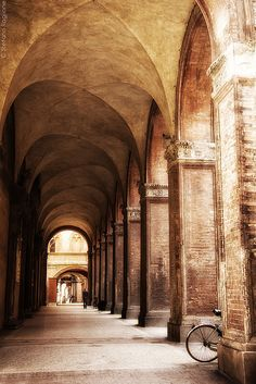 Bologna, Italy where you can walk almost anywhere in the city under the protection of the porticos. June 2014