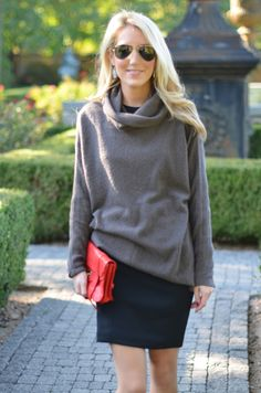 Krystal Schlegel - love the baggy sweater over a black dress