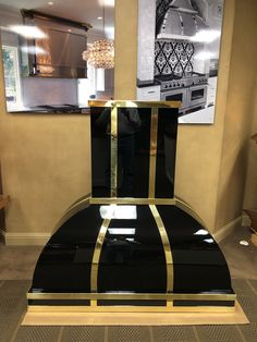 Handcrafted Custom Kitchen Vent Hood made from paint grip material with black lacquer finish and brass bands -- made for our customer Tim Jackson Custom Homes.  #Handcrafted #customkitchenventhood #architecturalmetalelements #luxurycustomhomes #luxurykitchens #indoordesign #interiordesign  #VentHoodEnvy #beachsheetmetal