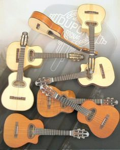 Guitares Maurice DUPONT. Ukuleles like gypsy jazz guitars.