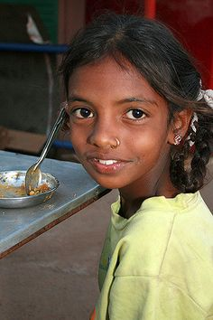 https://flic.kr/p/4wCkTP | Terre d'Espoir 7 | These are the children of Goa's migrant workers. Janine Gaiddon from France comes to Colva in South Goa for five months every year to help the children. She gives over a hundred a day breakfast, provides basic first aid and helps those who go to school remain by donating uniforms, stationery and giving them lunch. She is a truly amazing lady. She is funded by a small charity, Terre d'Espoir, which she and her late husband set up in their home…