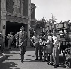 Vintage Disneyland  Walt Disney with some of the Mouskateers at the old Disneyland Fire Department