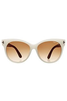 The subtle cat-eye silhouette of these Tom Ford sunglasses adds a retro feel, further enhanced by the chalk white frames and pale brown lenses #Stylebop