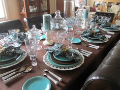 The Welcomed Guest. brown turquoise centerpiece glass jars will be filled with chocolate