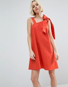 Buy it now. ASOS Bow and Tie Detail Sundress - Red. Dress by ASOS Collection, Lightweight cotton, One-shoulder neckline, Bow and tie detail, Loose fit � falls loosely over the body, Machine wash, 100% Cotton, Our model wears a UK 8/EU 36/US 4 and is 175 cm/5'9� tall. ABOUT ASOS COLLECTION Score a wardrobe win no matter the dress code with our ASOS Collection own-label collection. From polished prom to the after party, our London-based design team scour the globe to nail your new-season fa...