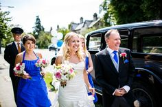 Bridal Party on the Way to The Church | Ian Stuart Bridal Gown | Rustic Wedding in a Barn in | Hand Sewn Cobalt Blue Bridesmaid Dresses | DIY Wild Flowers | Images by Lina & Tom | http://www.rockmywedding.co.uk/emily-luke/