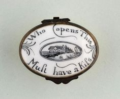 Yellow enamel oval patch box with porcelain lid bearing the lettering: 'Who opens this, Must have a Kiss'.