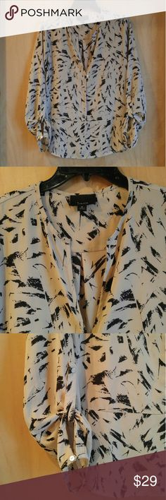 "FINAL PRICE Lumiere Brush Stroke Print Blouse Lumiere brand blouse, size medium, in excellent condition! Beige background with black paint brush stroke print. V-neck with single button. Tab button for rolling up sleeves. 21.5"" pit to pit, 26.5"" length. Shorter on sides. 100% polyester. Please ask any questions. No trades. Price firm. Thanks! Lumiere Tops Blouses"