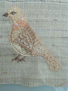 Crazy little stitched bird. Debbie Irving