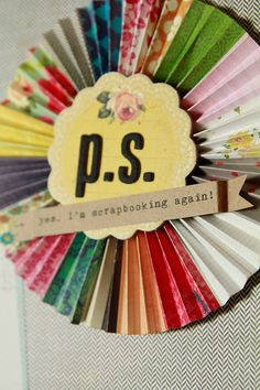 Love this rosette with different papers