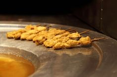Try Turkish Fried Mussels: Fried mussels on a stick, or 'midye tava,' is one of Istanbul's best street foods.