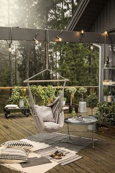 Relaxing outdoor swing chair on beautiful balcony.  I love how everything is put together