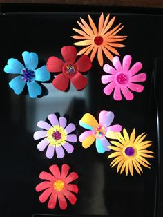 Flowers made of water bottles !!!!! Use glossy paint and cut them as you want too! Attach magnets to the back
