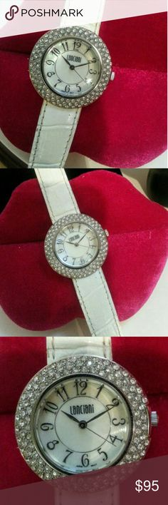 """Gorgeous crystal Lanciani ladies watch Made with Swarovski Crystals, this is high end costume jewelry. The watch is in perfect condition. Three surrounding rows of crystals and a Mother - of - Pearl face, and Italian white leather band.  There is a small scrape mark on the back from having the battery replaced. The watch is 1.25"""" in diameter. Lanciani Accessories Watches"""