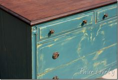 Two layers of chalk paint.  First coat is green to show through when sanded.