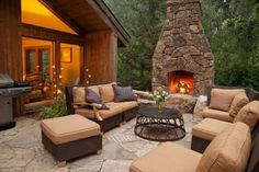 http://www.gopret.com/wp-content/uploads/2014/10/nice-outdoor-fireplace-stone-mantel-with-brown-fabric-sofa-and-metal-table-along-with-stone-floor-801x533.jpg