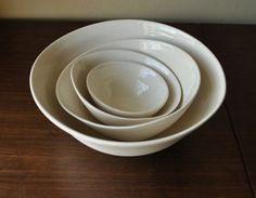"French Vanilla Nesting Bowls: Creamy white porcelain stoneware with vanilla ""specks""."