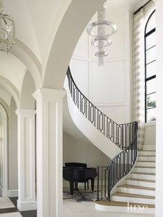 Contemporary White Staircase with Arched Walkways
