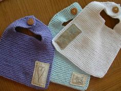 Garter stitch knitted bibs...cute little sewn on patches