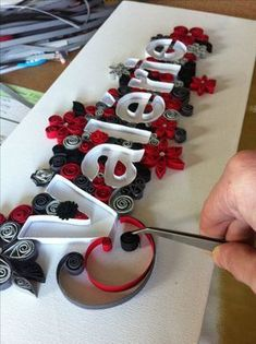 Name table quilling in progress - Quilling Paper Crafts Quilling Letters, Arte Quilling, Paper Quilling Patterns, Origami And Quilling, Quilled Paper Art, Quilling Paper Craft, Paper Crafts, Quilling Ideas, Quilling Tutorial