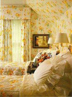 Yellow floral bedroom - vintage feel, swing arm lamps over the bed for reading, ruffled shams