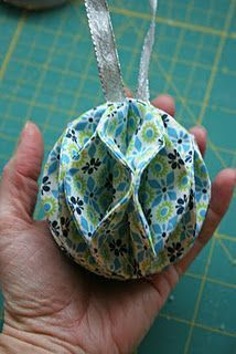Fabric ornament I've made similiar with Christmas Cards, but this is really neat. Nine circles of fabric. add stabilizer to stiffen fabric(Diy Ornaments Fabric) Fabric Christmas Decorations, Folded Fabric Ornaments, Quilted Christmas Ornaments, Paper Ornaments, Christmas Sewing, Gold Ornaments, Christmas Fabric Crafts, Homemade Decorations, Dough Ornaments