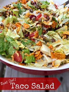 Aunt Sue's Taco Salad - a. Dorito's Taco Salad --This taco salad is famous in our family. It's easy to make and full of yummy veggies, beans, beef and cheese, crushed Doritos are mixed in and then it's topped with a tangy Italian dressing. Taco Salad Doritos, Taco Salad Recipes, Mexican Food Recipes, Beef Recipes, Dinner Recipes, Cooking Recipes, Healthy Recipes, Taco Taco, Taco Dip