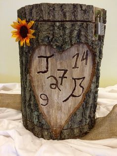 Haven't you always wanted to carve your initials in a heart on a tree? This rustic display doubles as your card holder!